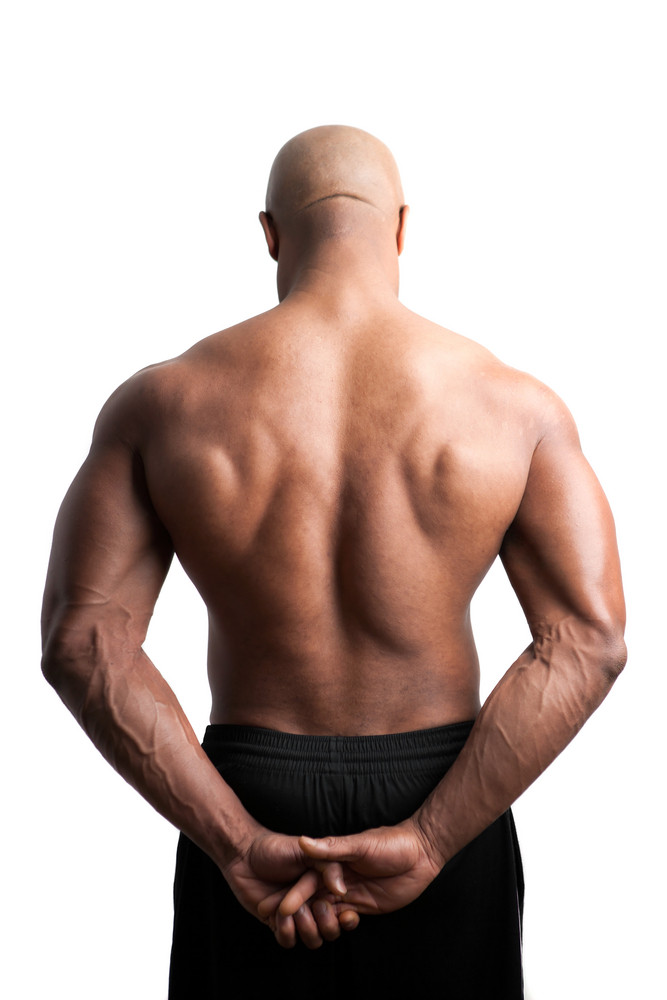 Toned and ripped body builder with a muscular back. Royalty-Free ...