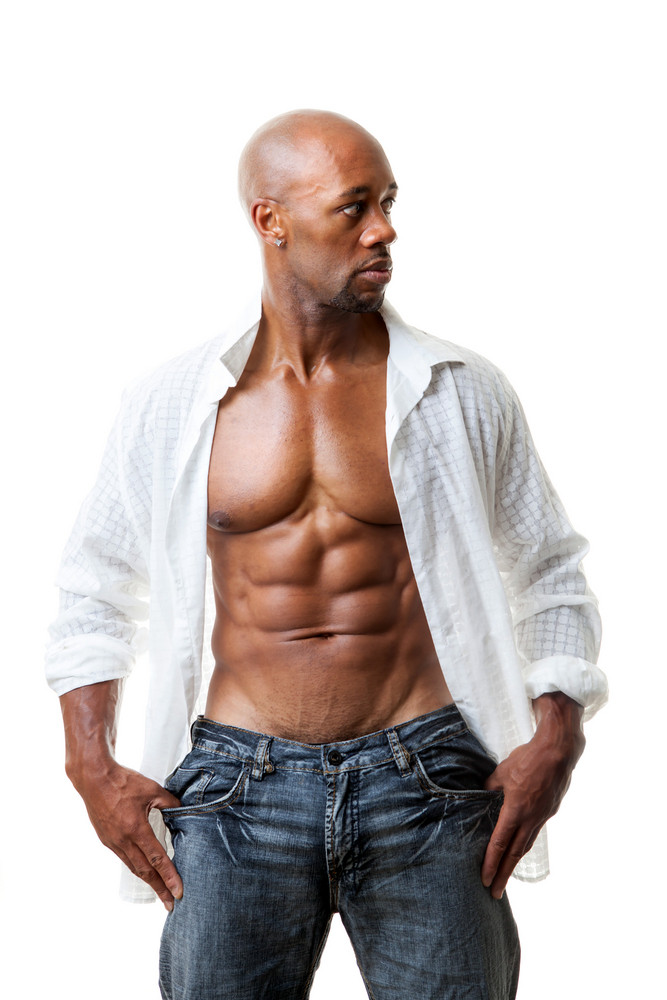 toned and ripped lean muscle fitness man wearing an open shirt