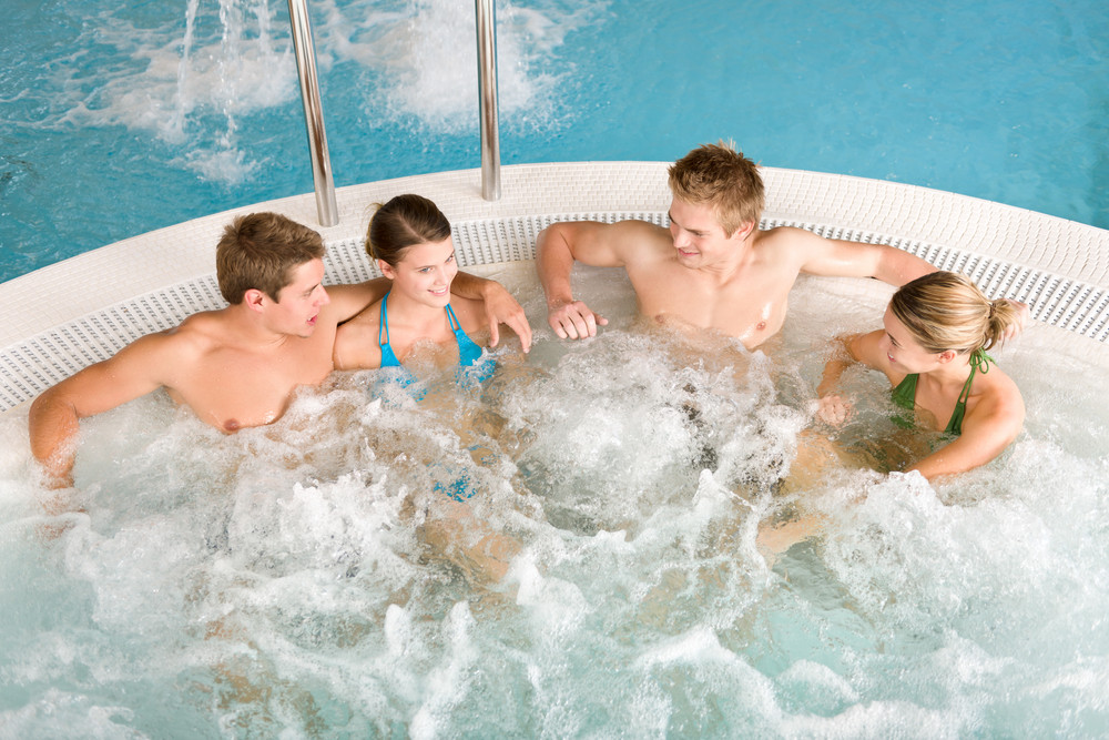 Top view  - happy young people relax in hot tub