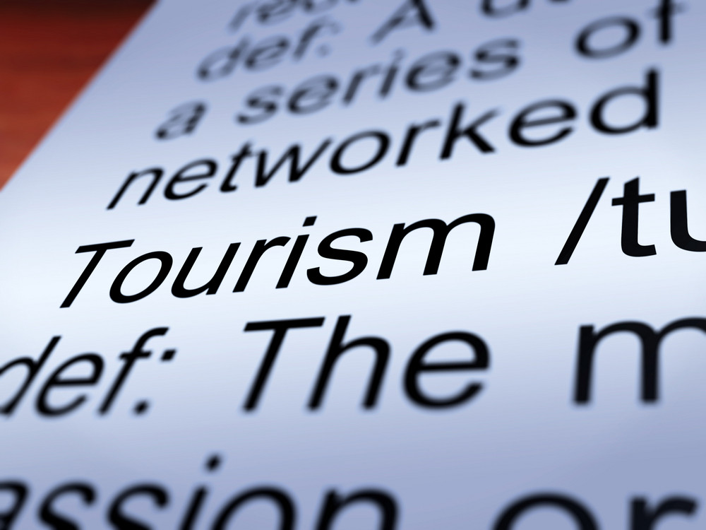 Tourism Definition Closeup Showing Traveling