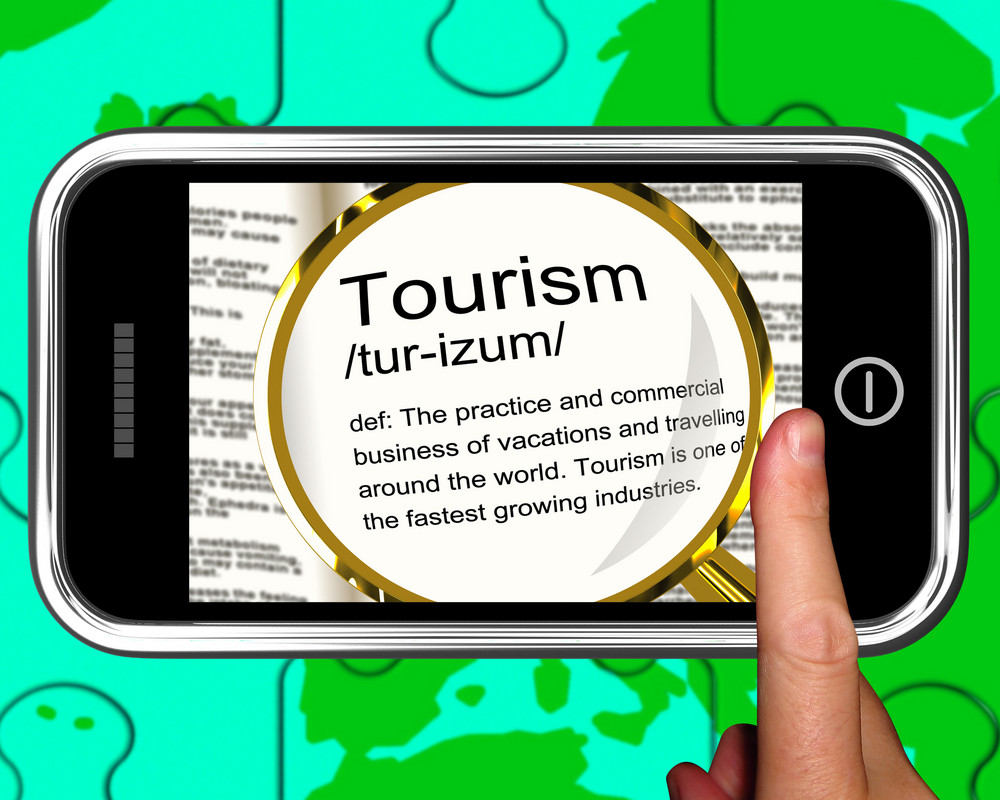 Tourism Definition On Smartphone Shows Traveling Abroad