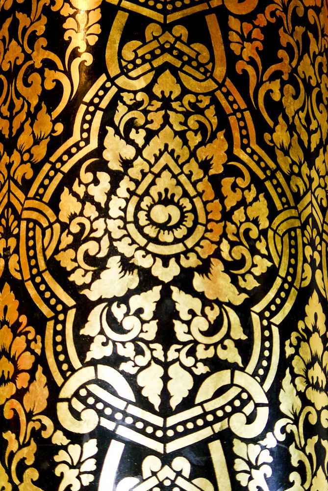 Traditional Thai fine art on a window and door pattern Temple Chiangmai Thailand