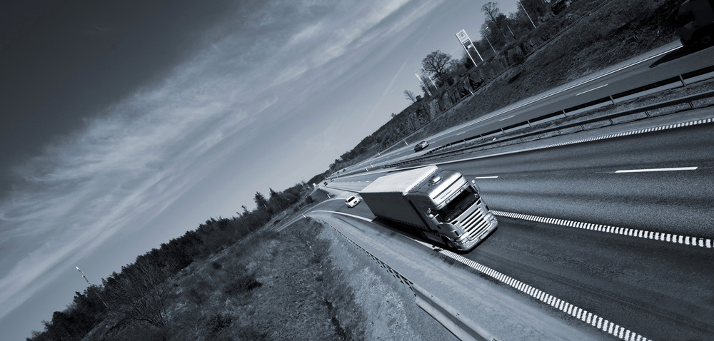 truck driving on straight freeway