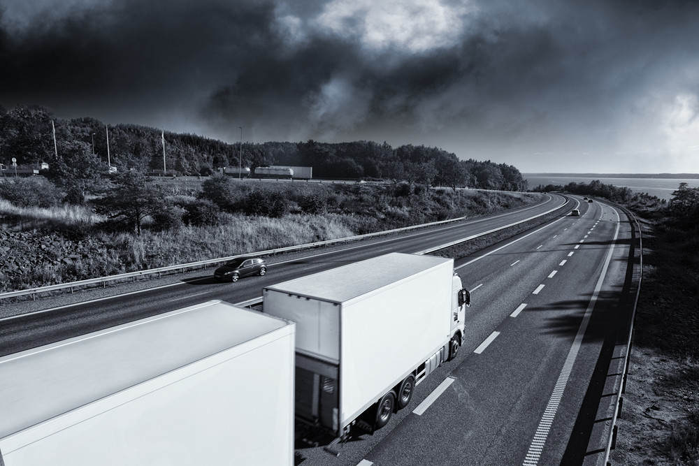 trucking on freeway, storm clouds approaching