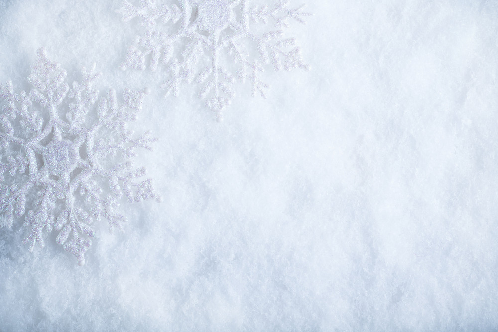 White Christmas Snow Background.Two Beautiful Sparkling Vintage Snowflakes On A White Frost