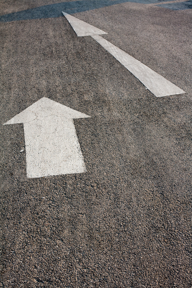 Two forwarded big white arrow on the road