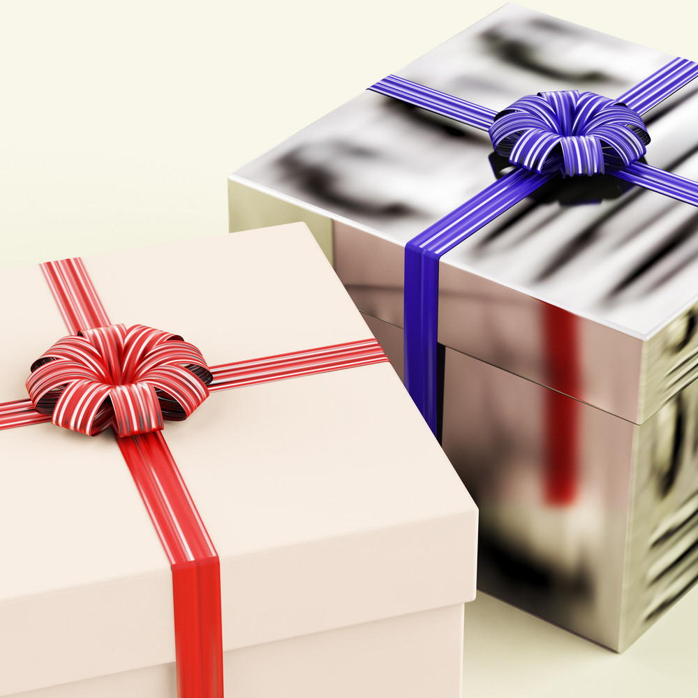 Two Gift Boxes With Blue And Red Ribbons As Presents For Him And Her