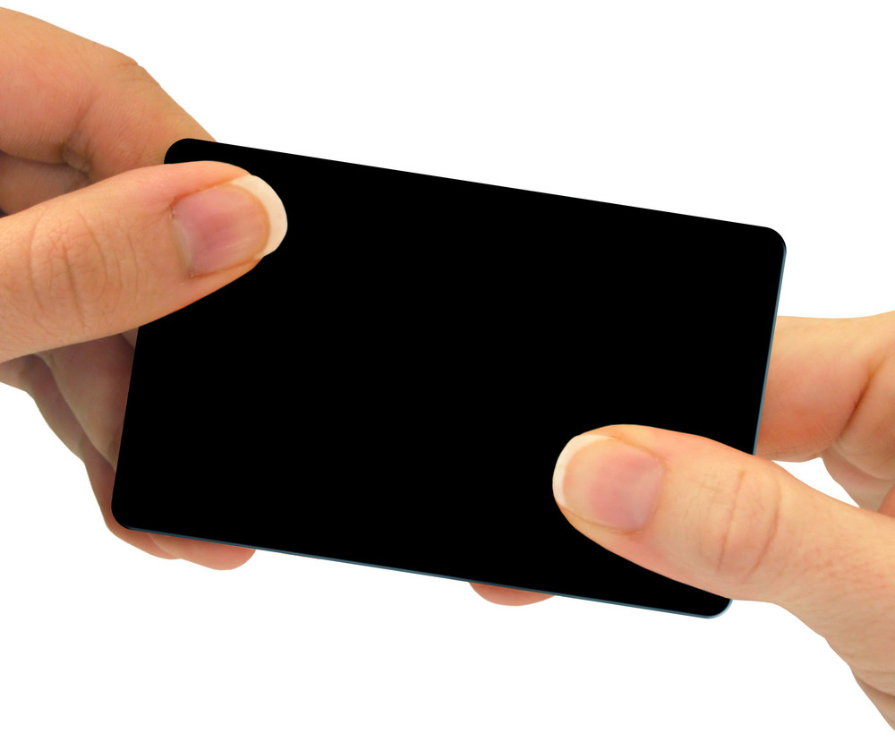 Two hands exchanging a blank card - this can be a business card, a gift card, or even a credit card - just to name a few different options.  Use your imagination!  Includes clipping path.