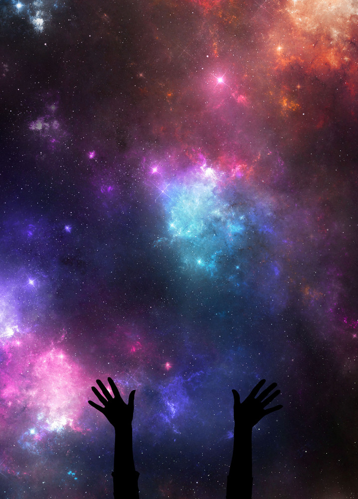 Two hands reach up in praise in the night sky.