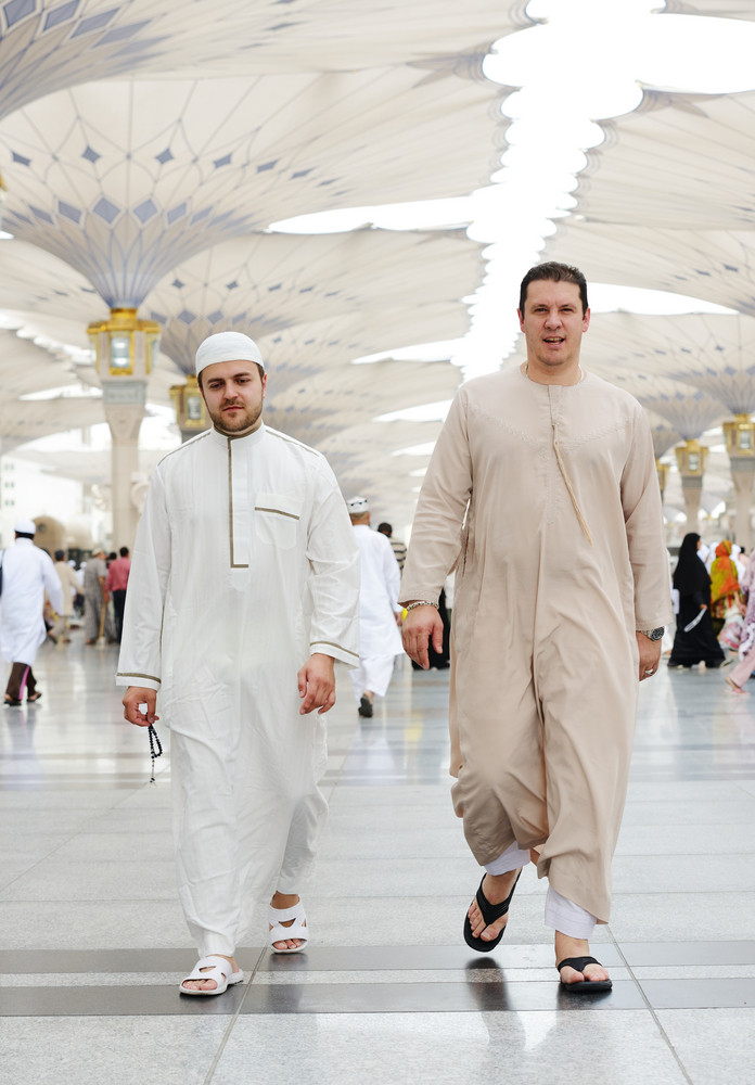 Two Muslim men walking together