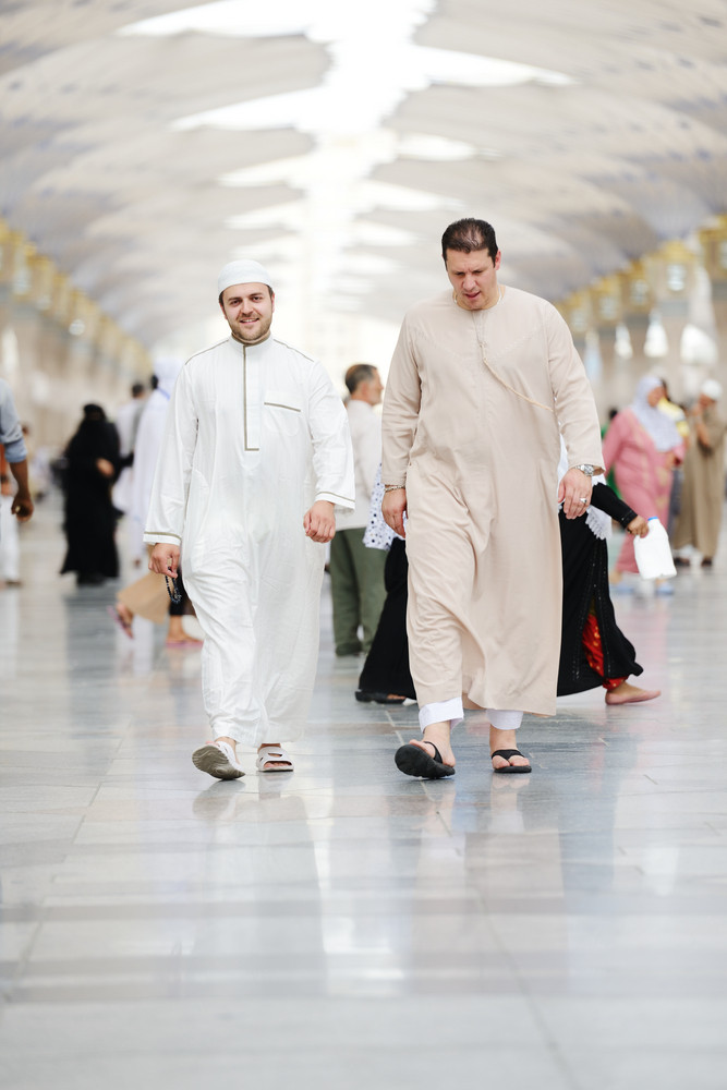Two Muslim men walking together