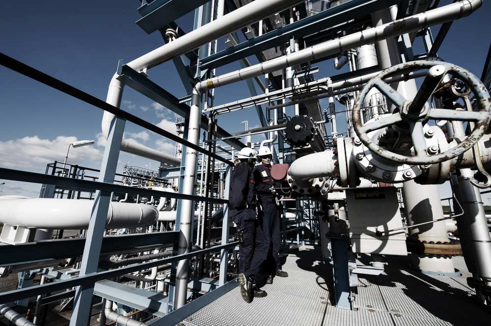 two oil engineers inside refinery