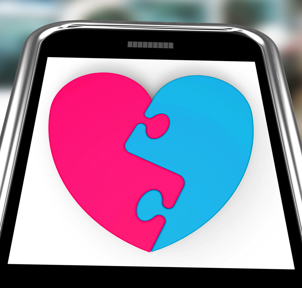 Two-pieced Heart On Smartphone Showing Complement