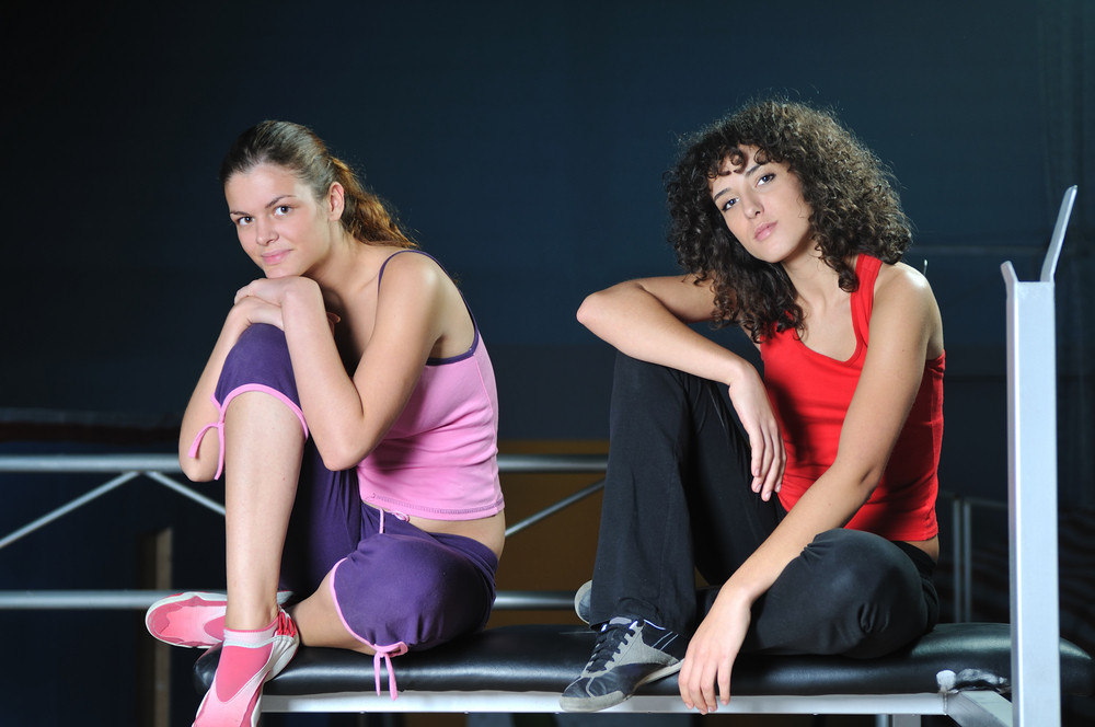 Two pretty girls in fitness club