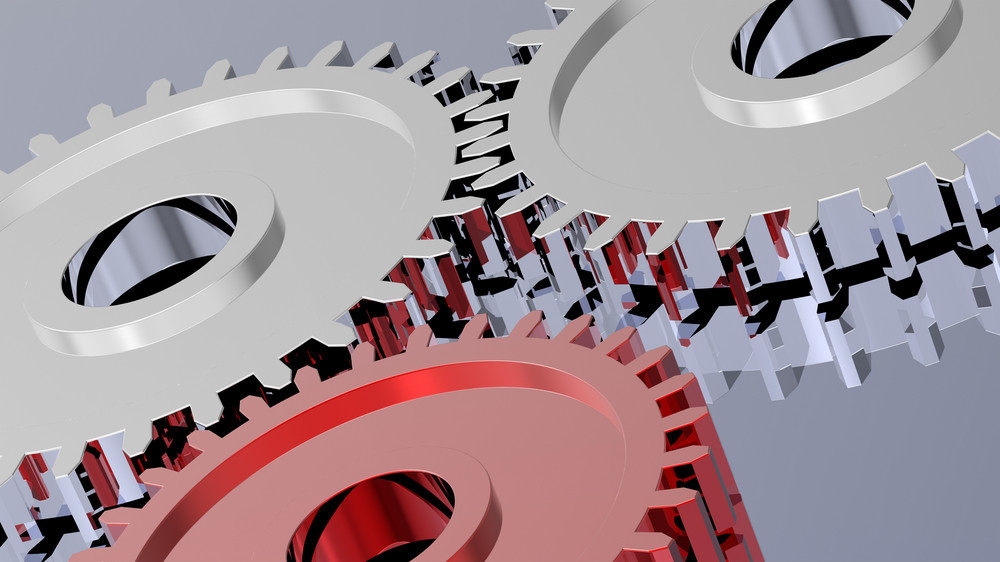 Two Steel Gears In Connection With Red One