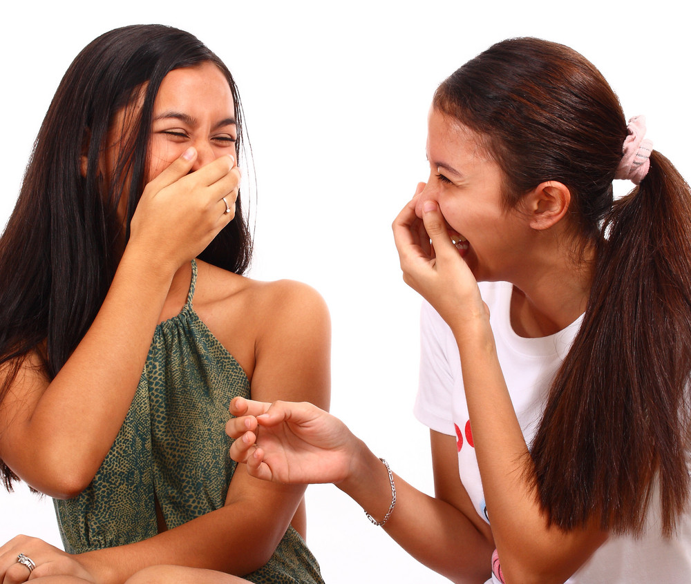 Two Teenager Girls Laughing And Giggling