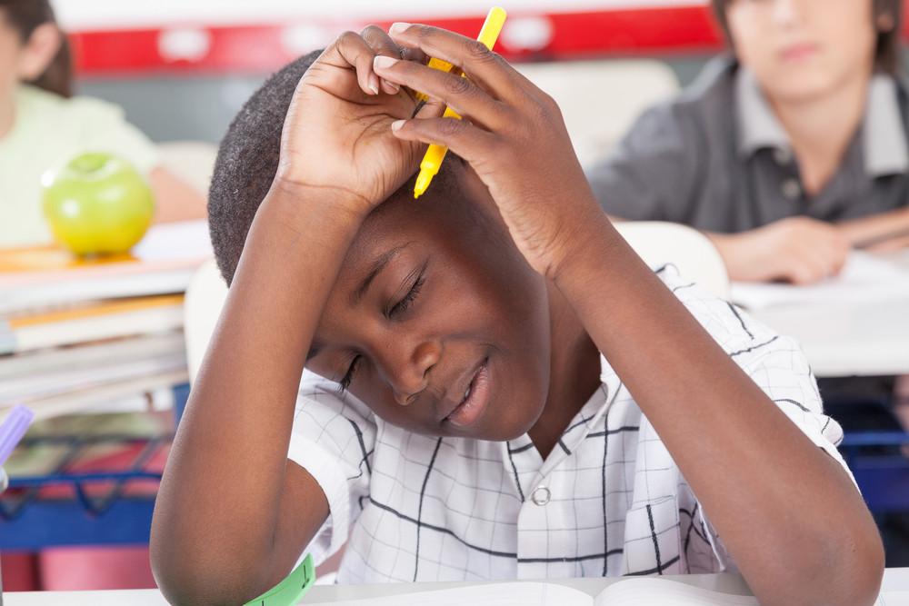upset boy in the classroom