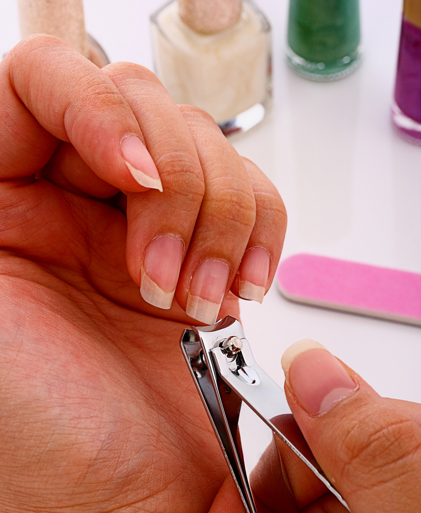 Using Clippers To Trim Her Nails