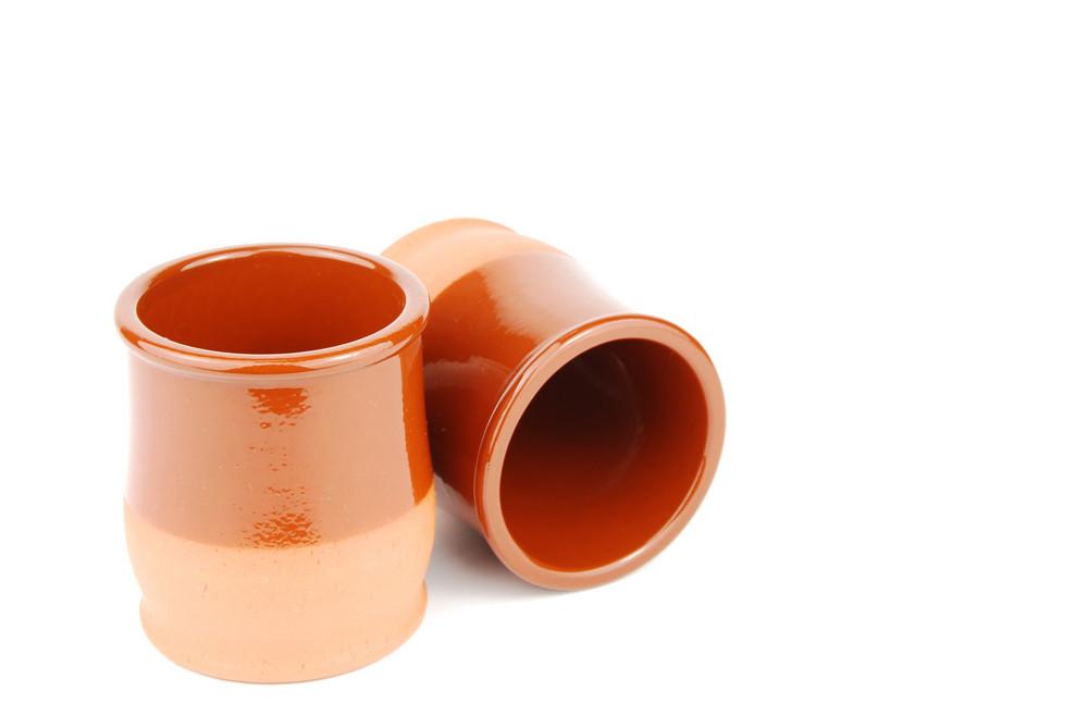 Vibrant Orange Ceramic Planting Pots On White