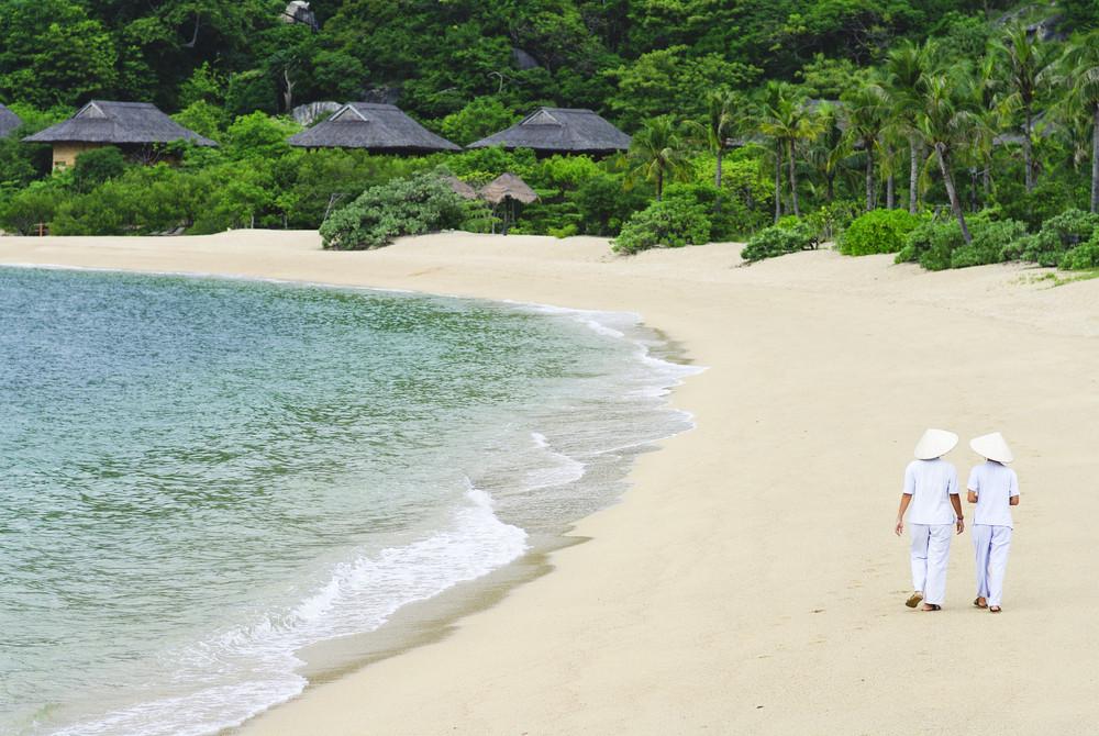 Vietnamese Woman walking on the beach
