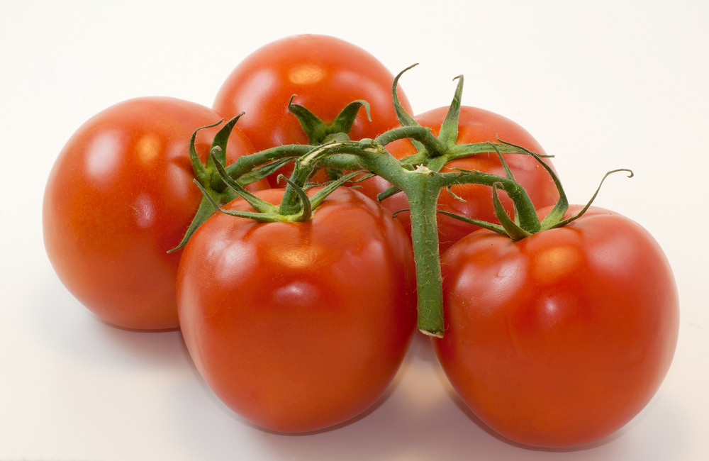 Vine Ripe Tomatoes And Knife