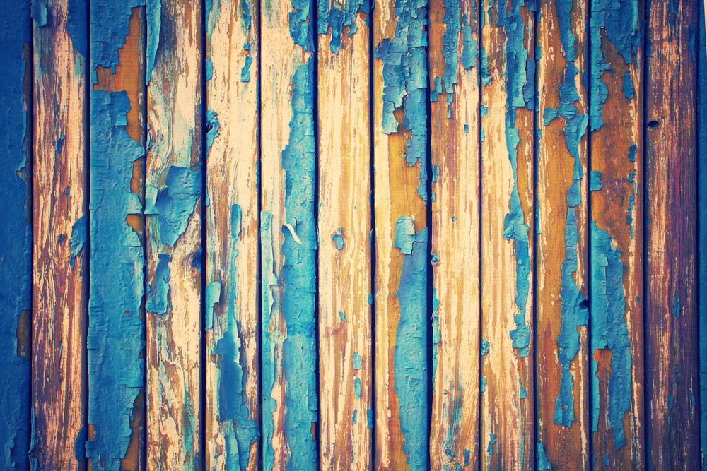 vintage background from old wooden wall with peeling paint royalty
