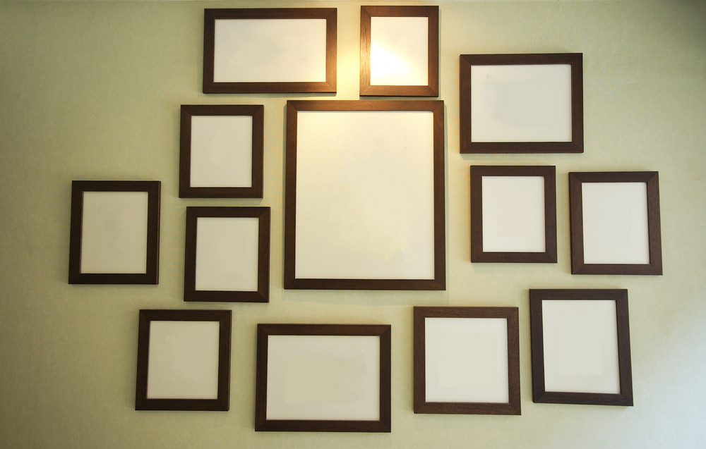 vintage blank photo frame on wall