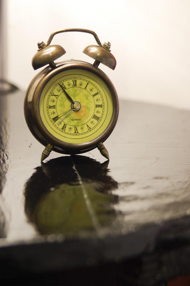 Vintage clock on wood table