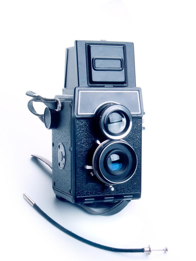 Vintage Photo Camera On White