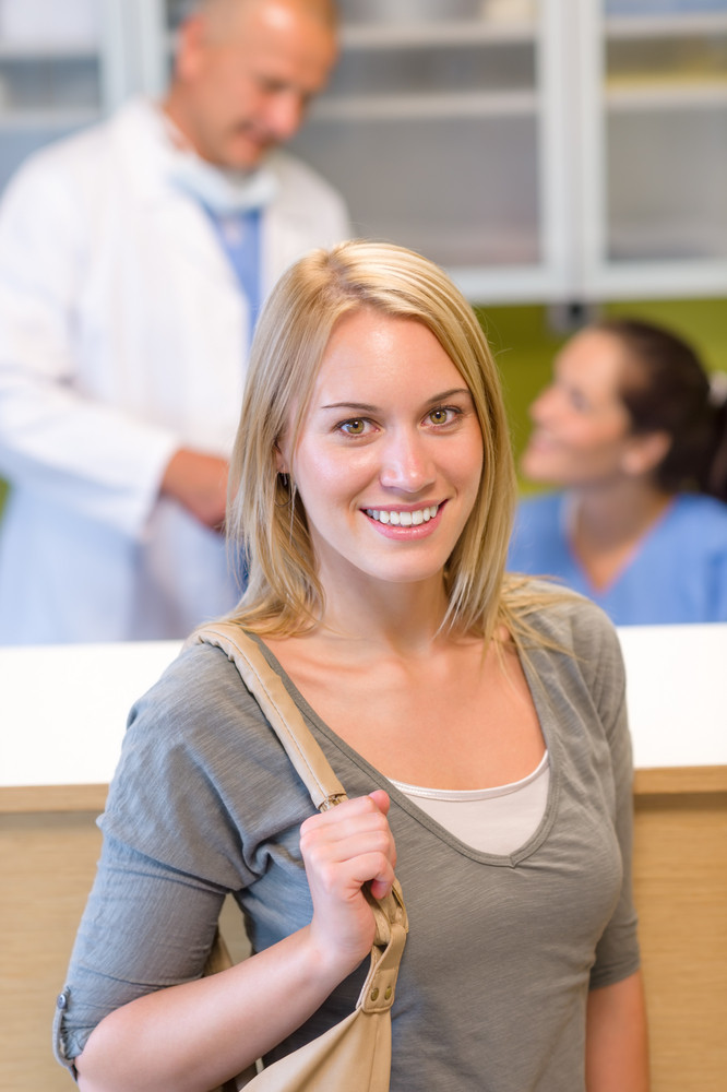 Visit at the dentist beautiful smile woman check-in appointment reception