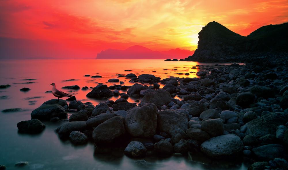 Sunset over a rocky coast