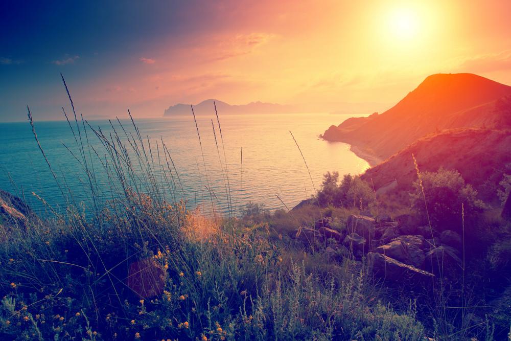 Beautiful sunset over rocky sea coast