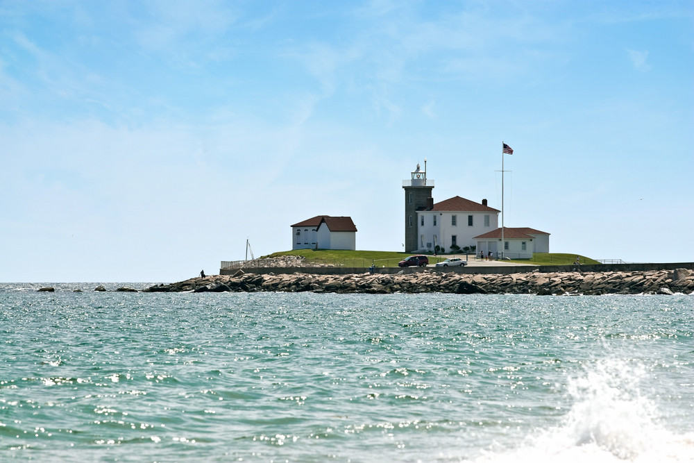 Watch Hill Rhode Islands historic lighthouse at the end of the jetty.