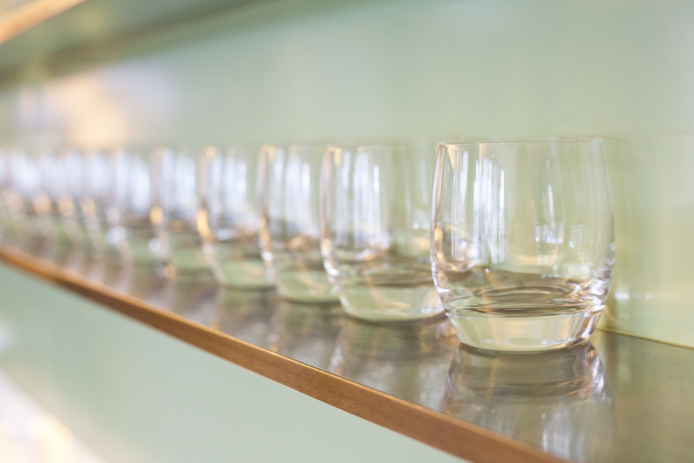 water glass on wooden rack