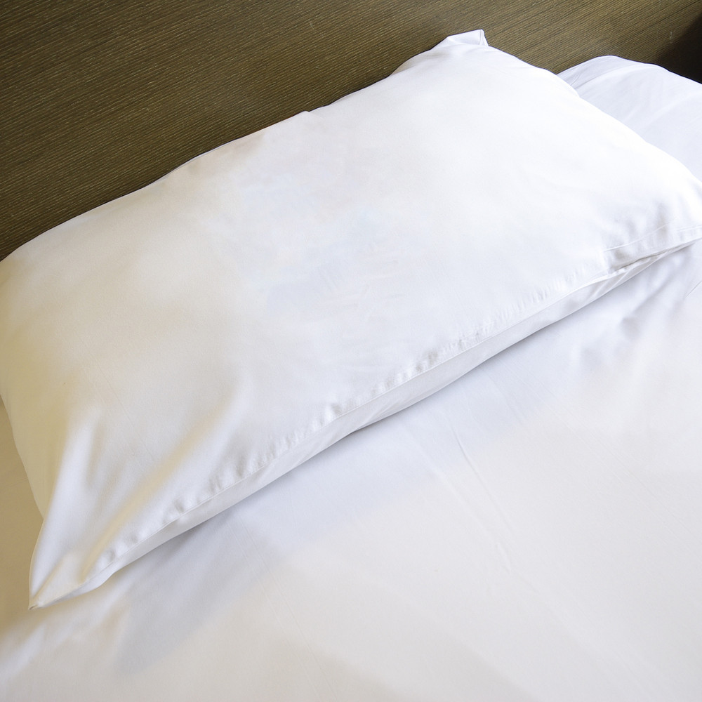 White pillow clean on bedroom