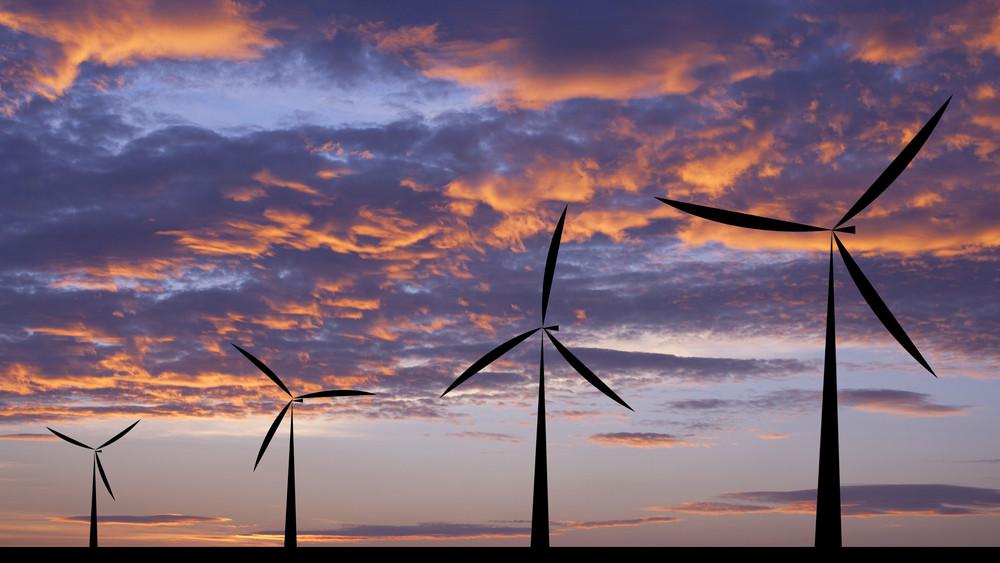 Wind turbine silhouette sunset or sunrise economic system background