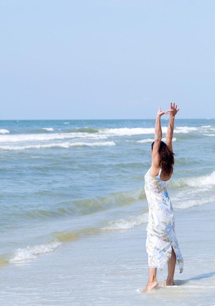 Woman At The Ocean Beach
