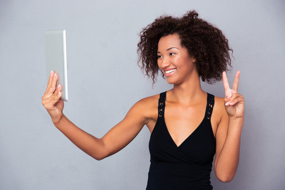 Woman making video call on tablet computer