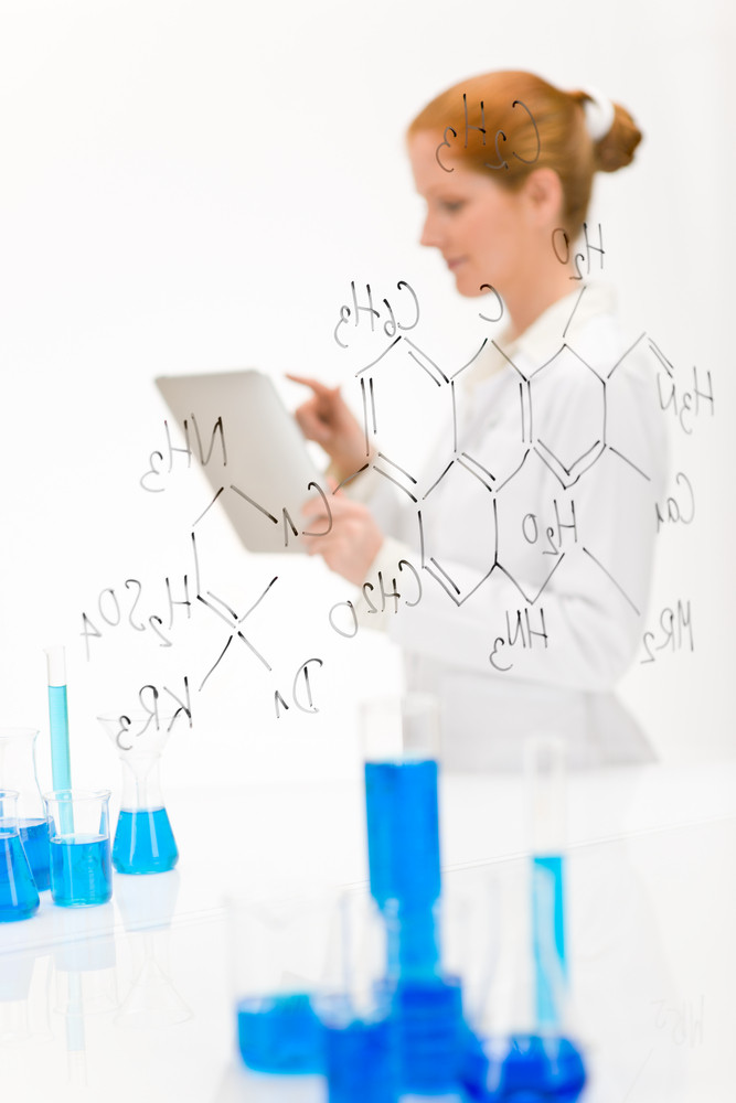 Woman scientist in laboratory research with touch screen computer