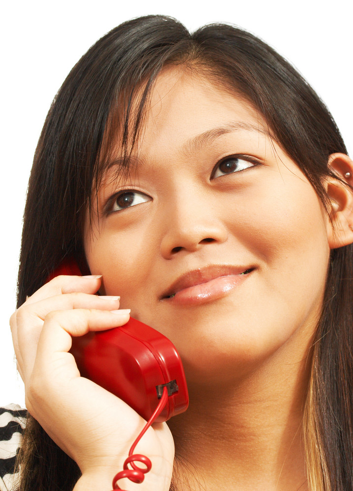 Woman Talking On A Landline Phone