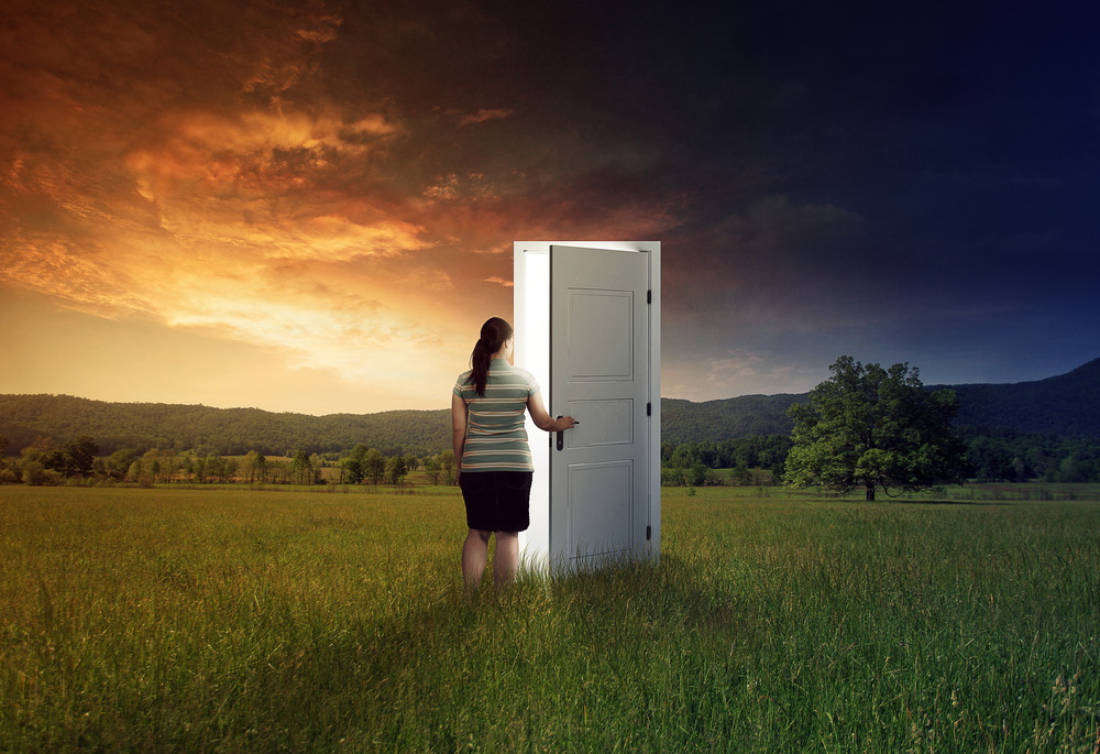 Woman walking through a door in the field
