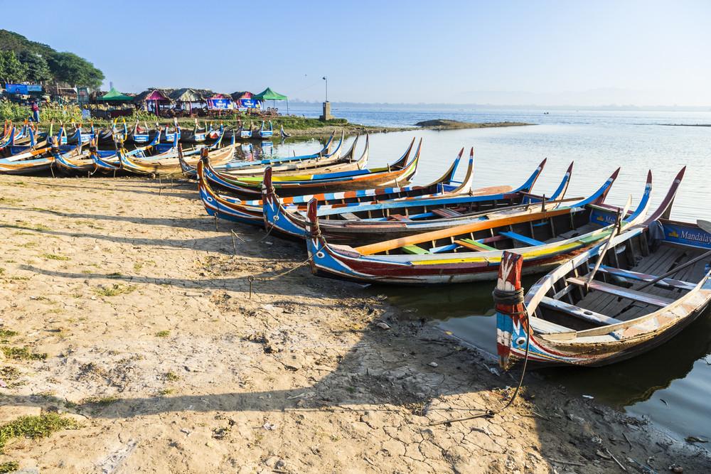 Wood boat Myanmar style at Ubein bridge. Mandalay. Myanmar