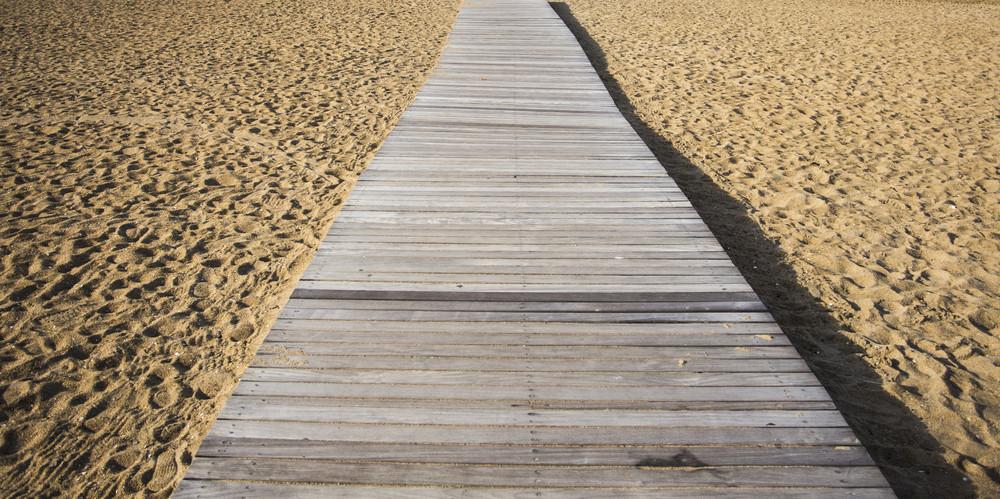 Wood bridge on beach