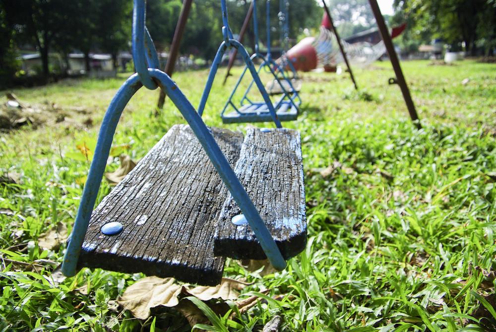 Wood swing on kid garden