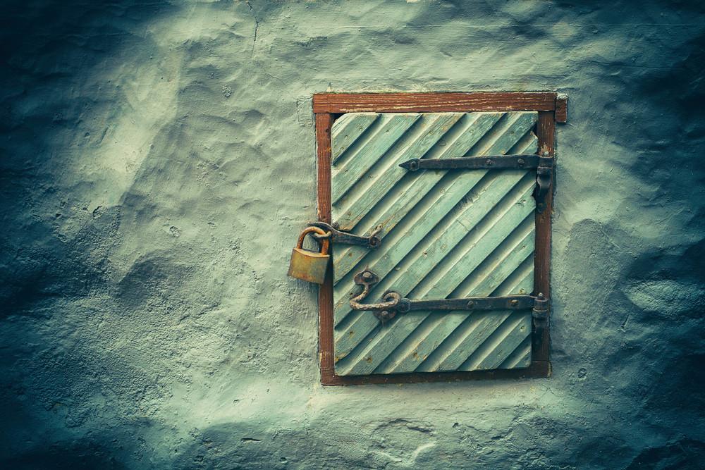 Wooden door in grunge concrete wall