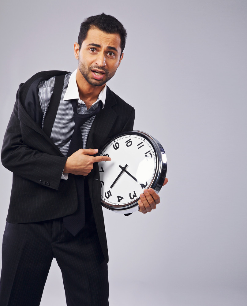Worried businessman pointing to his clock