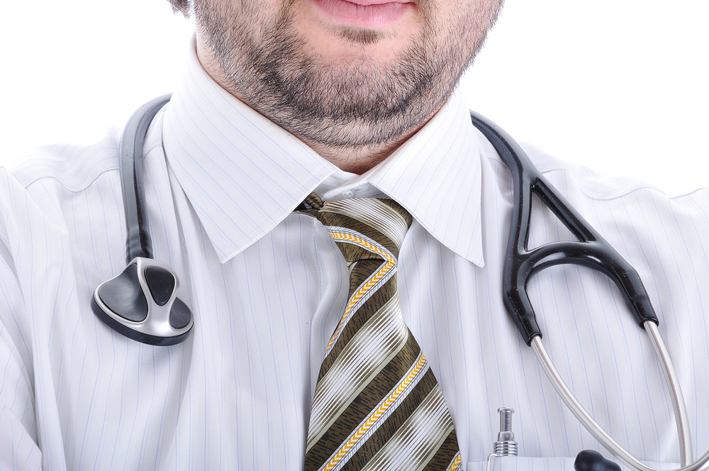 Young attractive male doctor in characteristic clothes