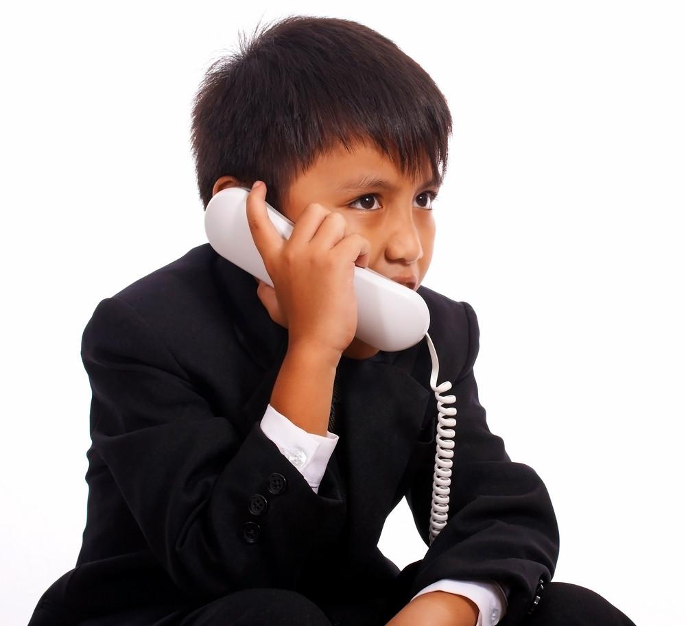 Young Boy On A Landline Phone
