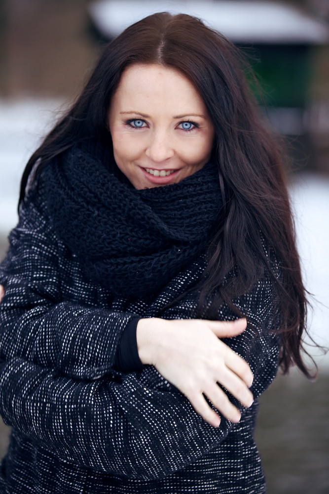 Young Brunette Woman in the Freezing Cold Park