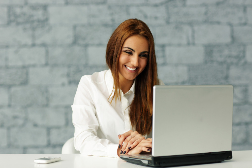Young businesswoman working on laptop in office